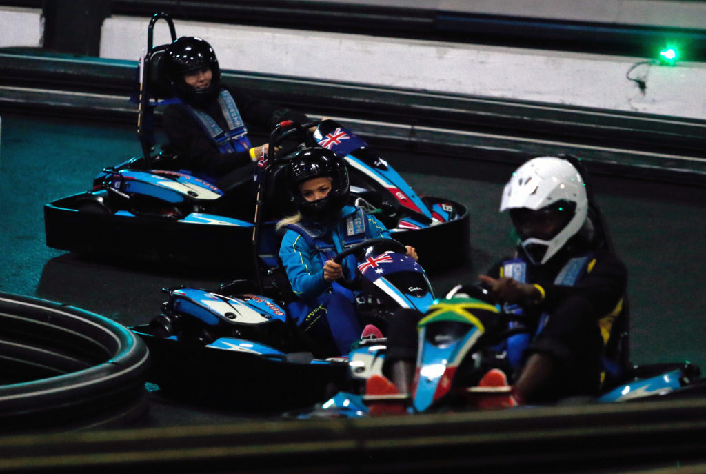 New Zealand's Storm Purvis, Australia's Kate Moloney & Jamaica's Jhaniele Reid-Fowler all swap the netball court for the go-kart track